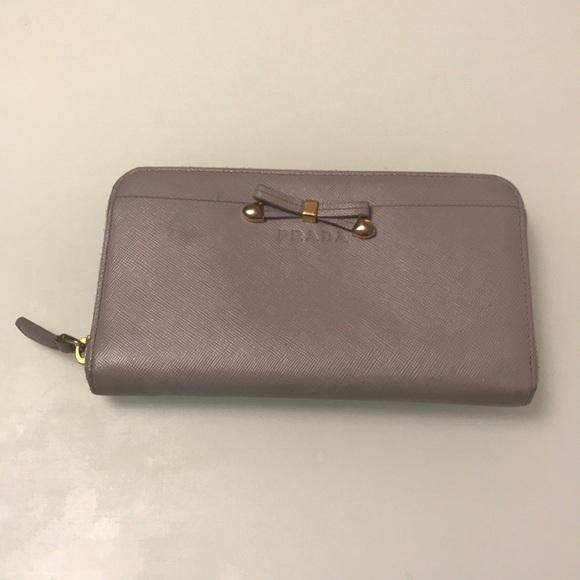 5caee498178078 Prada Lavender zip around wallet. M_5b8b968fd8a2c79801054829